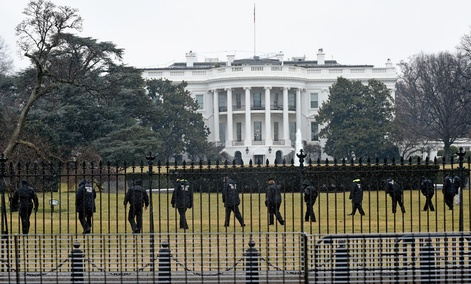 Secret Service officers search the south grounds of the White House after a  device, possibly an unmanned aerial drone, was found on the White House grounds.