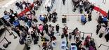 Passengers line up to pass through the TSA security before boarding flights at John F. Kennedy International Airport.