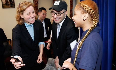 CTO Megan Smith shares a laugh with a middle school student from Newark, N.J. and Code.org Founder Hadi Partovi, center, after teaching U.S. President Barack Obama how to code at the White House.