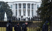 Secret Service officers search the south grounds of the White House after a drone accidentally crashed there.