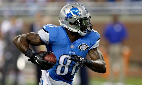Detroit Lions wide receiver Calvin Johnson runs for a 67-yard touchdown reception during the first quarter of an NFL football game against the New York Giants in Detroit. Johnson is one of the most traded players in CBS Sports and Yahoo fantasy leagues.