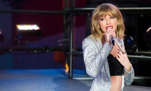 Taylor Swift performs in Times Square during New Year's Eve celebrations.