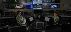 Two airmen in the Global Strategic Warning and Space Surveillance System Center at Cheyenne Mountain Air Force Station, Colo., on Sept. 2, 2014.