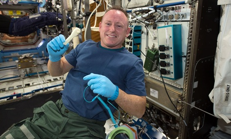 "International Space Station Expedition 42 Commander Barry ""Butch"" Wilmore shows off a ratchet wrench made with a 3-D printer on the station."