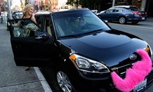 A passenger gets out of a car driven by Dara Jenkins, a driver for the ride-sharing service Lyft,
