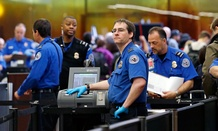 TSA agents work at a security check-point at Seattle-Tacoma International Airport in SeaTac, Wash.