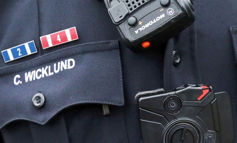 Sgt. Chris Wicklund of the Burnsville, Minn. Police Department wears a body camera beneath his microphone.
