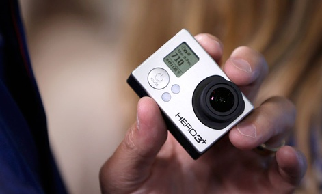 A GoPro camera is held during the GoPro IPO at the Nasdaq MarketSite in New York