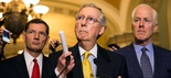 Senate Majority Leader Mitch McConnell of Ky., accompanied by Sen. John Barrasso, R-Wyo., left, and Senate Majority Whip John Cornyn of Texas., speaks during a news conference on Capitol Hill.