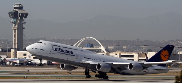 A Lufthansa Boeing 747-830, takes off from the south runaway at the Los Angeles International Airport.