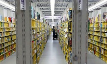 An Amazon.com employee stocks books at the Amazon.com Fulfillment Center in Phoenix.