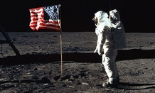 Astronaut Buzz Aldrin, lunar module pilot of the first lunar landing mission, poses for a photograph beside the deployed United States flag during an Apollo 11 Extravehicular Activity (EVA) on the lunar surface.