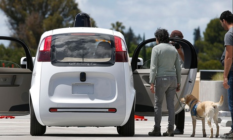 Riders enter the Google's new self-driving prototype car for a ride during a demonstration at Google campus on Wednesday, May 13, 2015.