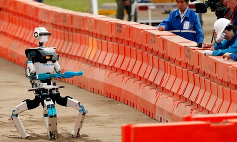University of Tokyo robot Aero DRC competes in he first stage of the U.S. Defense Advanced Research Projects Agency Robotics Challenge in Pomona, Calif.