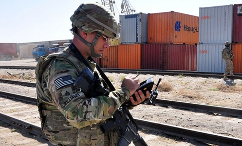 An Army soldier uses a handheld portable deployment kit to scan for U.S. cargo at a northern Afghanistan port, on Sept. 21, 2012.