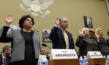 OPM Director Katherine Archuleta, left, and others, are sworn in on Capitol Hill in Washington, Wednesday, June 24, 2015, prior to testifying before the House Oversight and Government Reform Committee hearing on recent cyber attacks. From left are, Archul
