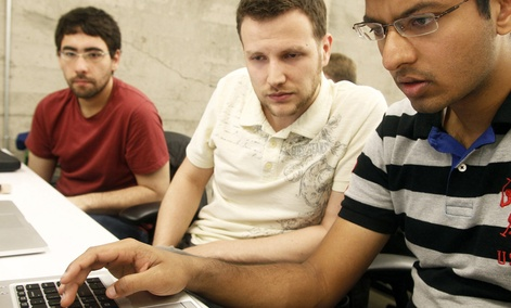 Shiva Gopalan, a computer engineering masters student at Texas A&M University (far right), confers with IBM developers Henrique Copelli Zambon (center) and Luiz Aoqui, during an IBM hosted Spark Hackathon in San Francisco on June 14, 2015.