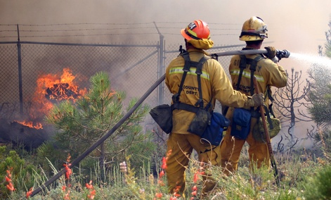 Los Angeles County firefighters fight a fire near Wrightwood, Calif.