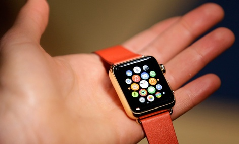 A woman holds the Apple Watch Edition during a demo following an Apple event Monday, March 9, 2015, in San Francisco.
