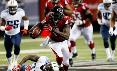Atlanta Falcons wide receiver Julio Jones (11) runs against Tennessee Titans strong safety Bernard Pollard (31) during the first half of an NFL preseason football game in Atlanta.