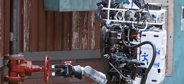 Robot Running Man from the Florida Institute for Human and Machine Cognition proceeds to turn a valve in the next stage of the competition during the DARPA Robotics Challenge.