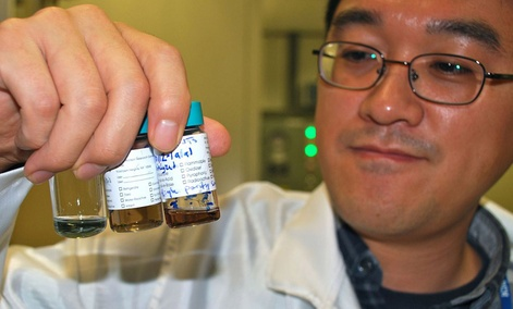 An IBM researcher observes different solutions of carbon nanotubes.
