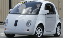 Google's new self-driving prototype car drives around a parking lot during a demonstration at the Google campus.