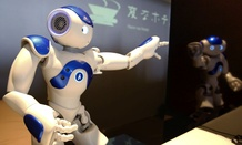 A receptionist robot performs during a demonstration for the media at a new hotel in Japan.