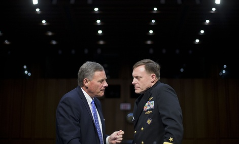 Senate Intelligence Committee Chairman Richard Burr talks with National Security Agency Director Adm. Michael Rogers on Capitol Hill on Sept. 24.