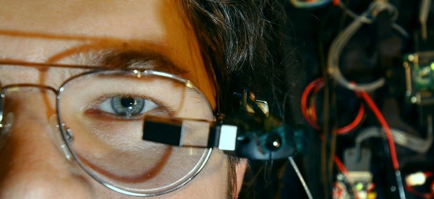 In this 2003 photo, Richard W. DeVaul, a MIT graduate student, wears a tiny computer display mounted on eyeglass frames at the MIT Media Lab.