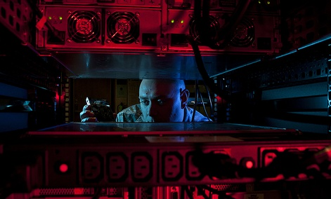 U.S. Air Force Staff Sgt. Jerome Duhan, a network administrator with the 97th Communications Squadron, inserts a hard drive into the network control center retina server at Altus Air Force Base, Okla.