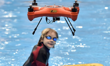 A water drone demonstrates maritime salvage by flying a lifesaver to a boy in the water, at the world's largest watersports trade fair BOOT in Duesseldorf, Germany, Friday, Jan. 22, 2016.