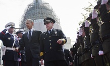 President Barack Obama walks in with Chuck Canterbury, President Grand Lodge Fraternal Order of Police, right, on Capitol Hill in Washington, Friday, May 15, 2015.