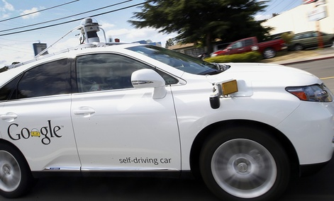 Google's self-driving Lexus car drives along street during a demonstration at Google campus in Mountain View, Calif.
