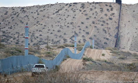 A U.S. Border Patrol agent drives near the U.S.-Mexico border fence in Sunland Park, N.M.