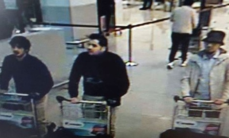 In this image provided by the Belgian Federal Police in Brussels on Tuesday, March 22, 2016, three men who are suspected of taking part in the attacks at Belgium's Zaventem Airport and are being sought by police.