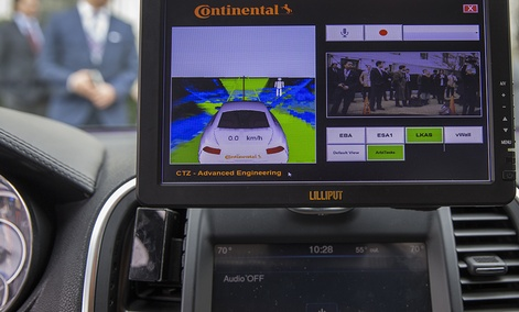 A display inside a Tesla Model 90D during a demonstration of self driving car technology on Capitol Hill, on Tuesday, March 15, 2016.