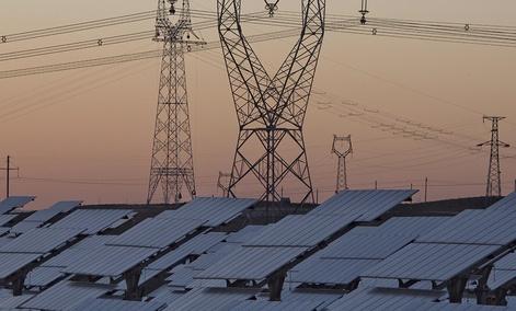 Solar panels are seen near the power grid in northwestern China's Ningxia Hui autonomous region.
