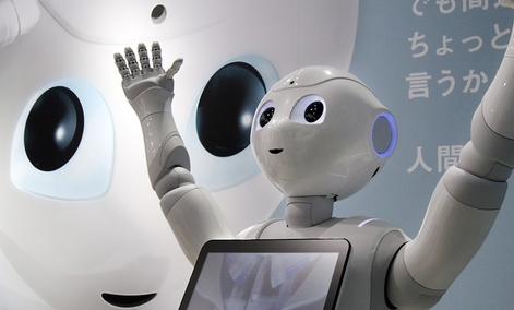 """Humanoid Robot """"Pepper"""" is displayed at SoftBank Mobile shop in Tokyo."""