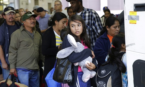 Immigrants from El Salvador and Guatemala who entered the country illegally board a bus after they were released from a family detention center in San Antonio.