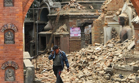 A Nepalese man cries as he walks through the earthquake debris in Bhaktapur, near Kathmandu, Nepal. The violence of the 7.8-magnitude earthquake left countless towns and villages across central Nepal in a shambles.