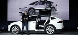 Elon Musk, CEO of Tesla Motors Inc., introduces the Model X car at the company's headquarters Tuesday, Sept. 29, 2015, in Fremont, Calif.