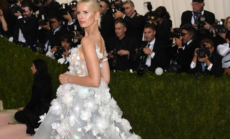 Karolina Kurkova arrives at The Metropolitan Museum of Art Costume Institute Benefit Gala with a 'cognitive' dress that had 150 LED lights which changed color when fed data from IBM's Watson.