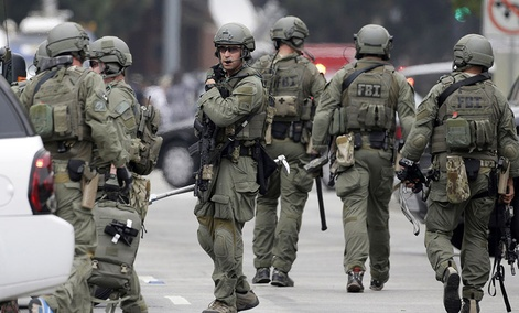 An FBI SWAT team arrives at the scene of a fatal shooting at the University of California, Los Angeles.