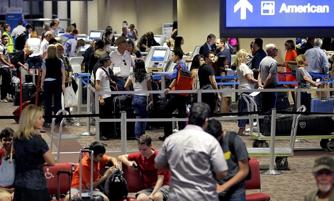 Passengers line up to check in before their flight at Sky Harbor International Airport in Phoenix.