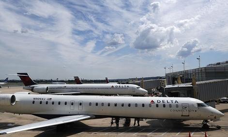 Delta Air Lines planes are seen on the tarmac at Washington's Ronald Reagan Washington National Airport, Monday, Aug. 8, 2016.