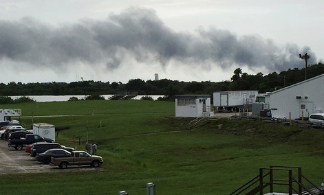 Smoke rises from a SpaceX launch site Thursday, Sept. 1, 2016, at Cape Canaveral, Fla. NASA said SpaceX was conducting a test firing of its unmanned rocket when a blast occurred.