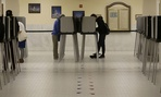 Voters cast ballots in voting booths at City Hall in San Francisco, Tuesday, June 7, 2016.