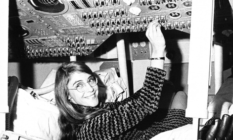 Margaret Hamilton of Cambridge, Mass., mathematic and computer programmer at the MIT Instrumentation Laboratory, sits in mock up of Apollo command module.