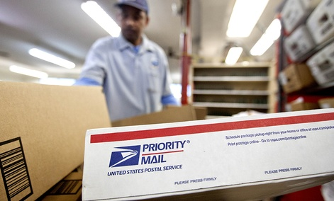 Packages wait to be sorted in a Post Office.